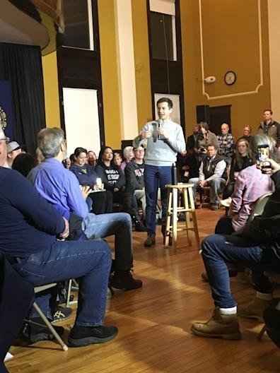 Democratic presidential hopeful Pete Buttigieg talks to voters at the city hall in Berlin, N.H., on Nov. 9, 2019.
