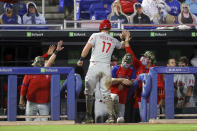Philadelphia Phillies' Rhys Hoskins is congratulated after scoring against the Toronto Blue Jays during the seventh inning of a baseball game Friday, May 14, 2021, in Dunedin, Fla. (AP Photo/Mike Carlson)