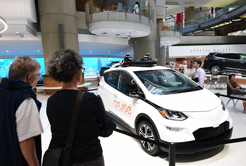 DETROIT, MICHIGAN, UNITED STATES - 2019/07/31: People admire a GM Cruise self-driving car on display at the General Motors world headquarters building in Detroit's Renaissance Center. (Photo by Paul Hennessy/SOPA Images/LightRocket via Getty Images)