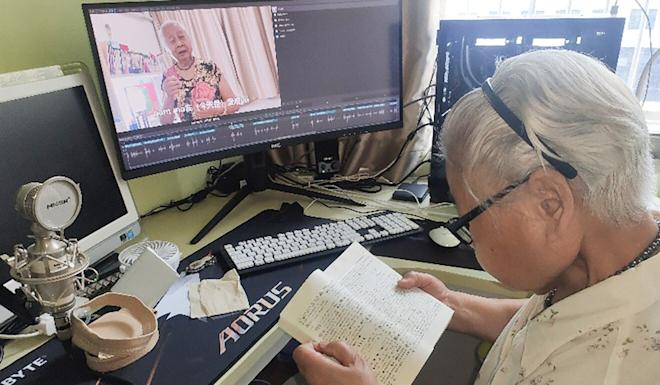 Jiang Minci, a retired railway engineer, checks the dictionary while preparing for a video, produced with the aid of her grandson. Photo: Handout