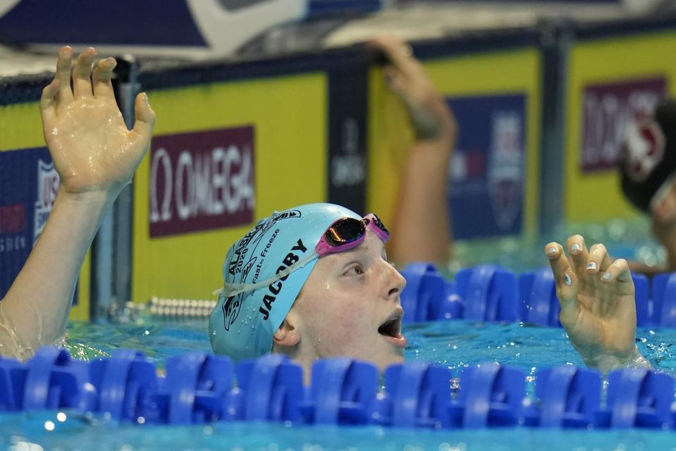 Lydia Jacoby reacts after winning her heat in the Women's 100 Breaststroke during wave 2 of the U.S. Olympic Swim Trials on Monday, June 14, 2021, in Omaha, Neb. (AP Photo/Jeff Roberson)