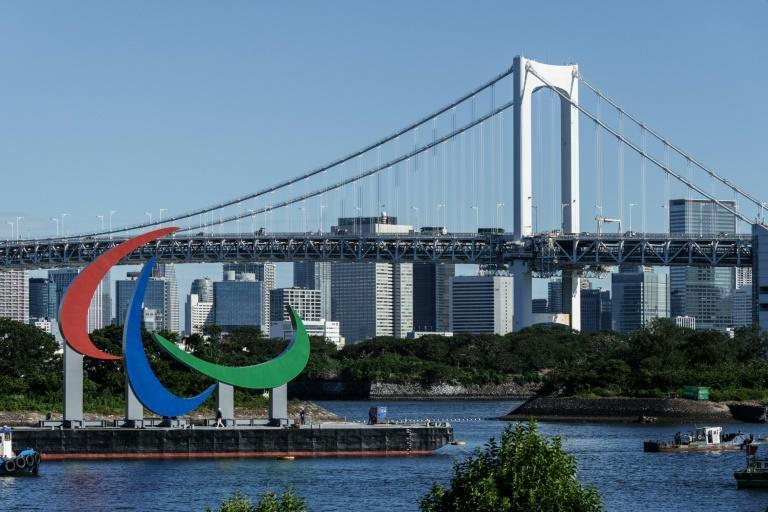 A giant red, blue and green Paralympic symbol was brought to the Tokyo waterfront on a barge