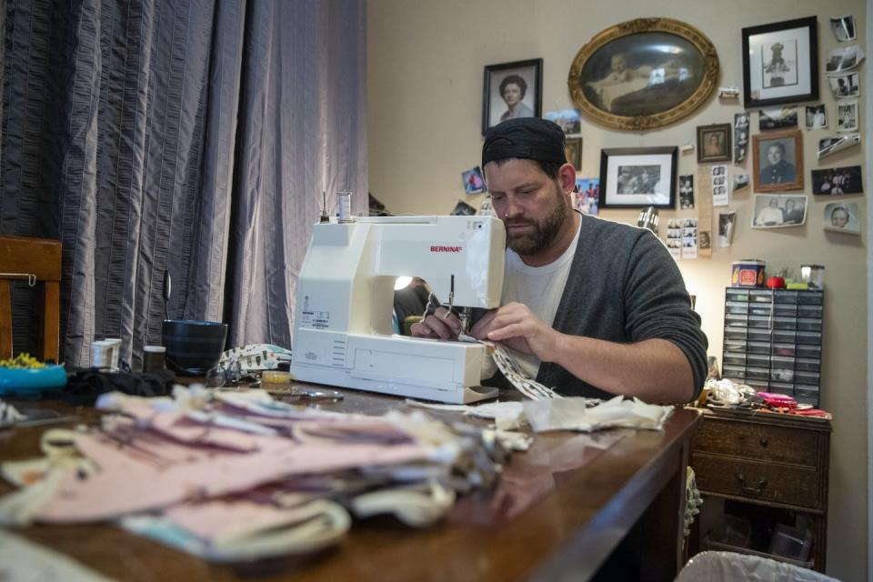 A man with a sewing machine.