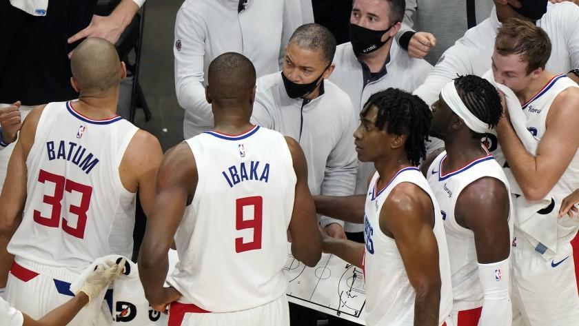 Los Angeles Clippers head coach Tyronn Lue, center, talks to his players during a timeout in the second half of an NBA basketball game against the Atlanta Hawks Tuesday, Jan. 2 6, 2021, in Atlanta. (AP Photo/John Bazemore)