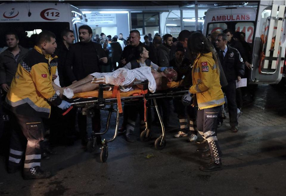 Rescue and medics carry a wounded person after attacks in Istanbul, late Saturday, Dec. 10, 2016. Two explosions struck Saturday night outside a major soccer stadium in Istanbul after fans had gone home, an attack that wounded about 20 police officers, Turkish authorities said. One of the blasts was thought to be a car bomb. Turkish authorities have banned distribution of images relating to the Istanbul explosions within Turkey.(AP Photo/Cansu Alkaya)