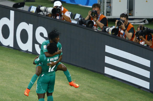 Ivory Coast's Bony celebrates with Gervinho after scoring a goal against Greece during their 2014 World Cup Group C soccer match at the Castelao arena in Fortaleza
