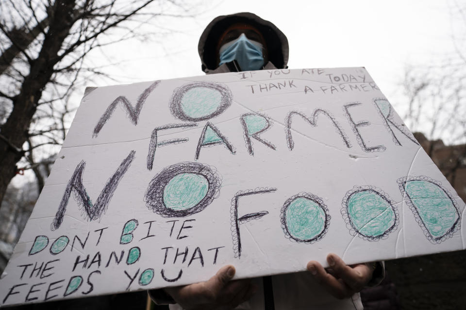 Protesters gather outside the Consulate General of India, Tuesday, Jan. 26, 2021, in the Manhattan borough of New York. Tens of thousands of protesting farmers have marched, rode horses and drove long lines of tractors into India's capital, breaking through police barricades to storm the historic Red Fort. The farmers have been demanding the withdrawal of new laws that they say will favor large corporate farms and devastate the earnings of smaller scale farmers. Republic Day marks the anniversary of the adoption of India's constitution on Jan. 26, 1950. (AP Photo/John Minchillo)