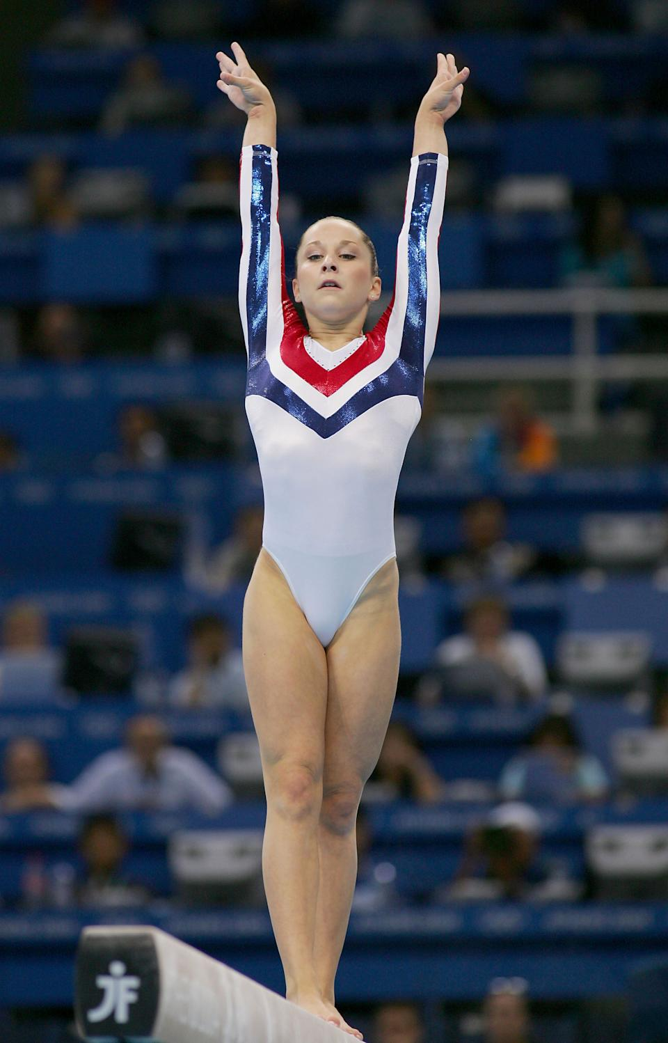ATHENS - AUGUST 23: Carly Patterson of Unites States competes in the women's artistic gymnastics balance beam finals on August 23, 2004 during the Athens 2004 Summer Olympic Games at the Olympic Sports Complex Indoor Hall in Athens, Greece. (Photo by Ezra Shaw/Getty Images)