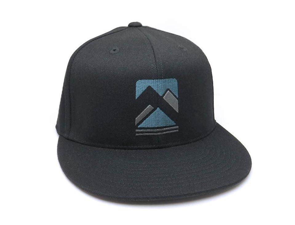 <p>If they love wearing baseball caps, or even have an extensive collection, get them this <span> Rustic Mountain Design Baseball Hat </span> ($33). You can choose from a flat bill, curved bill, snapback or fitted options.</p>