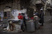 An ultra-Orthodox Jewish man dips cooking utensils in boiling water to remove remains of leaven in preparation for the upcoming Jewish holiday of Passover in Jerusalem, Friday, March 26, 2021. Jews are forbidden to eat leavened foodstuffs during the Passover holiday that celebrates the biblical story of the Israelites' escape from slavery and exodus from Egypt. (AP Photo/Oded Balilty)