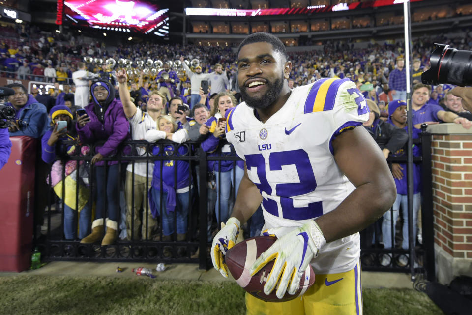FILE - In this Nov. 9, 2019, file photo, LSU running back Clyde Edwards-Helaire (22) grins after greeting fans following an NCAA football game Saturday against Alabama, in Tuscaloosa, Ala. Clyde Edwards-Helaire was one of three players from LSU's high-powered offense to earn unanimous first-team all-SEC honors when The Associated Press All-Southeastern Conference football team was announced Monday, Dec. 9, 2019. (AP Photo/Vasha Hunt, File)