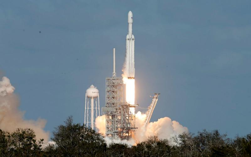 The SpaceX Falcon Heavy rocket lifts off from the Kennedy Space Center in Cape Canaveral - REUTERS