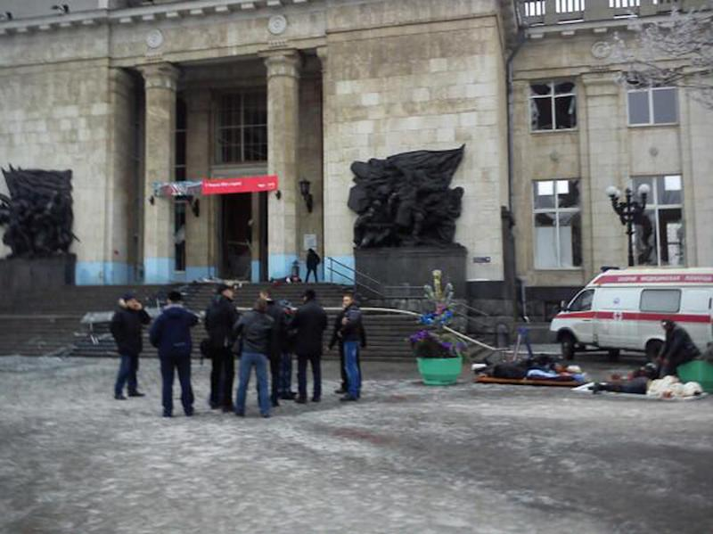 In this photo taken on a cell phone, made available by Volgograd Mayor's Office, medics help wounded people, at an entrance to Volgograd railway station, Sunday, Dec. 29, 2013. More then a dozen people were killed and scores were wounded Sunday by a suicide bomber at a railway station in southern Russia, officials said, heightening concern about terrorism ahead of February's Olympics in the Black Sea resort of Sochi. (AP Photo/Nikita Baryshev,Volgograd Mayor's Office Handout)