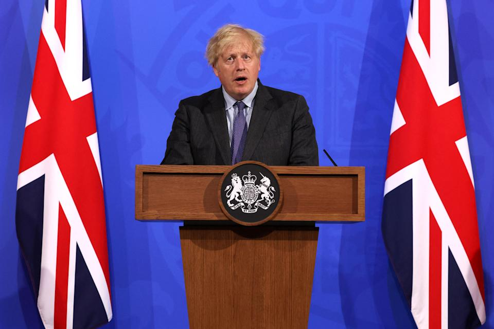 Britain's Prime Minister Boris Johnson gives an update on the coronavirus Covid-19 pandemic during a virtual press conference inside the Downing Street Briefing Room in central London on June 14, 2021. - British Prime Minister Boris Johnson on Monday announced a four-week delay to the full lifting of coronavirus restrictions for England due to a surge of infections caused by the Delta variant. (Photo by Jonathan Buckmaster / POOL / AFP) (Photo by JONATHAN BUCKMASTER/POOL/AFP via Getty Images)
