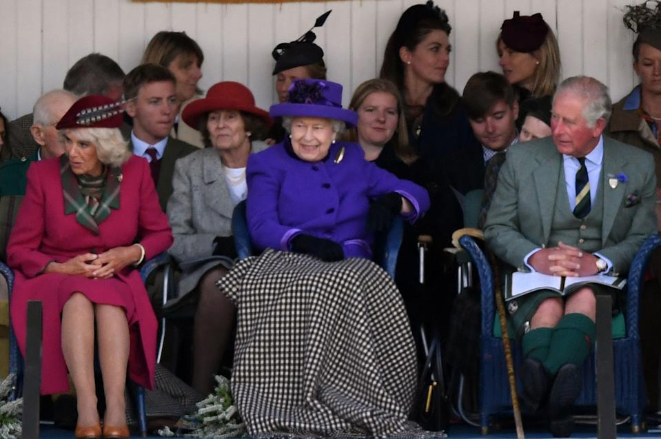 Britain's Queen Elizabeth II, accompanied by Britain's Camilla, Duchess of Cornwall and Britain's Prince Charles, Prince of Wales, looks on during the annual Braemar Gathering in Braemar, central Scotland, on September 7, 2019. - The Braemar Gathering is a traditional Scottish Highland Games which predates the 1745 Uprising, and since 1848 it has been regularly attended by the reigning Monarch Queen Elizabeth and members of the Royal Family. (Photo by ANDY BUCHANAN / AFP)        (Photo credit should read ANDY BUCHANAN/AFP via Getty Images)