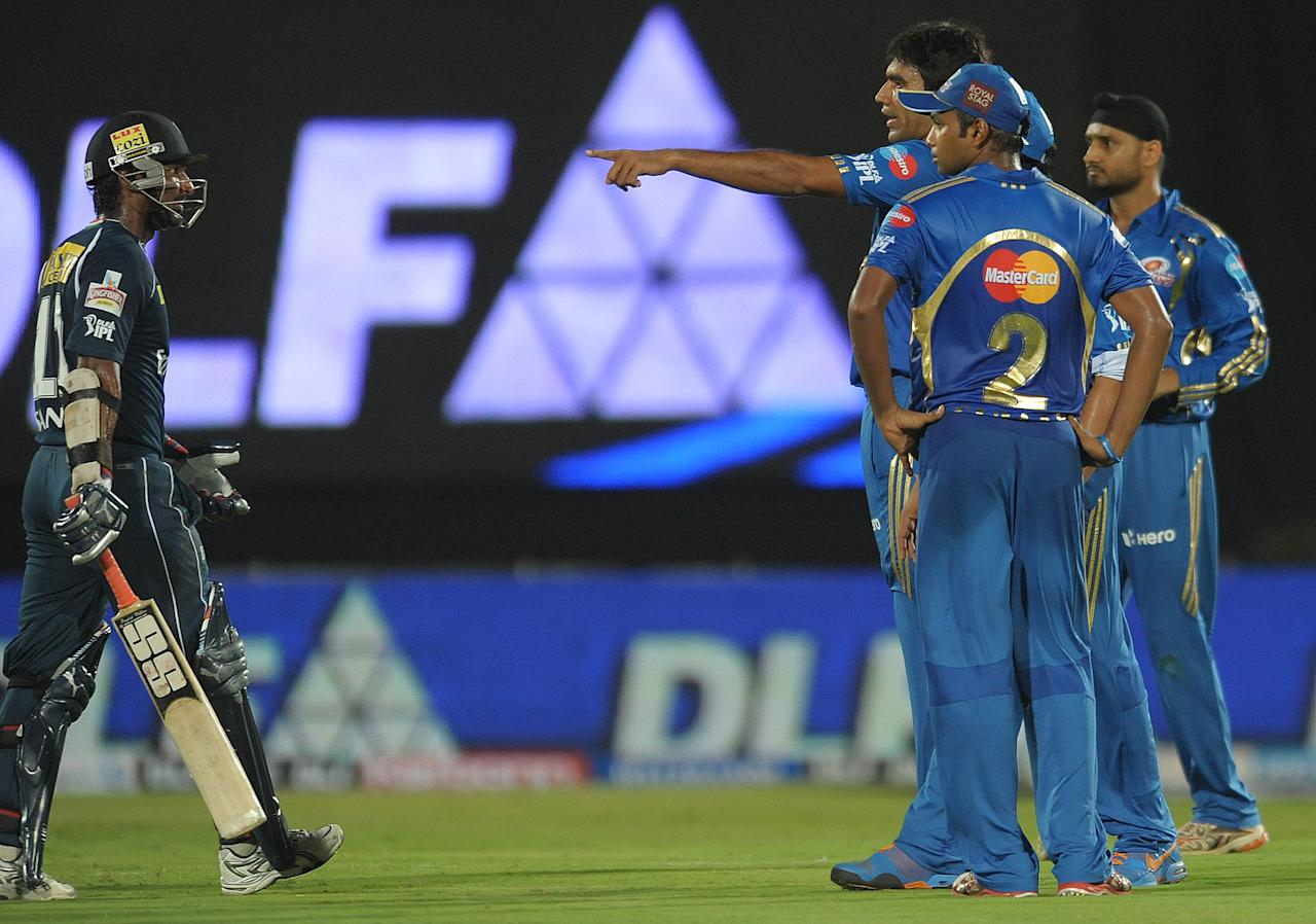 Mumbai Indians bowler Munaf Patel (3R) gestures towards Deccan Chargers captain Kumar Sangakkara (L) during the IPL Twenty20 cricket match between Deccan Chargers and Mumbai Indians at Dr. Y.S. Rajasekhara Reddy Cricket Stadium in Visakhapatnam on April 9, 2012.      RESTRICTED TO EDITORIAL USE. MOBILE USE WITHIN NEWS PACKAGE.    AFP PHOTO / Noah SEELAM (Photo credit should read NOAH SEELAM/AFP/Getty Images)