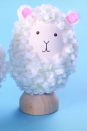"""<p>Mary had a little lamb, and you can have one too! All you need is some paint, a glue gun, and some silk flowers to make this adorable sheep.</p><p><strong><em><a href=""""https://www.womansday.com/home/crafts-projects/how-to/a58121/how-to-make-lamb-egg/"""" rel=""""nofollow noopener"""" target=""""_blank"""" data-ylk=""""slk:Get the Lamb Easter Egg tutorial."""" class=""""link rapid-noclick-resp"""">Get the Lamb Easter Egg tutorial. </a></em></strong></p>"""
