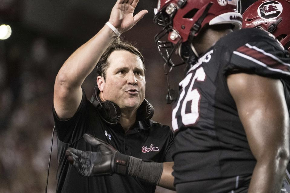 South Carolina head coach Will Muschamp welcomes players back to the sideline after a score against Kentucky during the first half of an NCAA college football game Saturday, Sept. 28, 2019, in Columbia, S.C. (AP Photo/Sean Rayford)