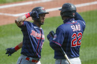 Minnesota Twins' Eddie Rosario, left, is greeted by Miguel Sano (22) after hitting a solo home run in the fifth inning of a baseball game against the Pittsburgh Pirates, Thursday, Aug. 6, 2020, in Pittsburgh. (AP Photo/Keith Srakocic)