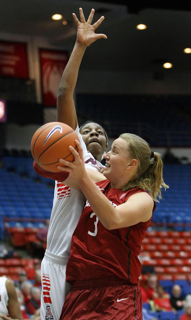 Stanford's Mikaela Ruef, right, shoots for two over the defense of Arizona's LaBrittney Jones in the first half of an NCAA college basketball game on Friday, Jan. 17, 2014, in Tucson, Ariz. (AP Photo/John Miller)