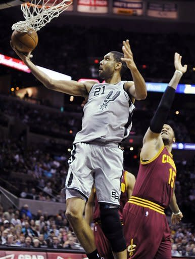 San Antonio Spurs forward Tim Duncan (21) shoots in front of Cleveland Cavaliers forward Marreese Speights during the first half of an NBA basketball game, Saturday, March 16, 2013, in San Antonio. (AP Photo/Bahram Mark Sobhani)