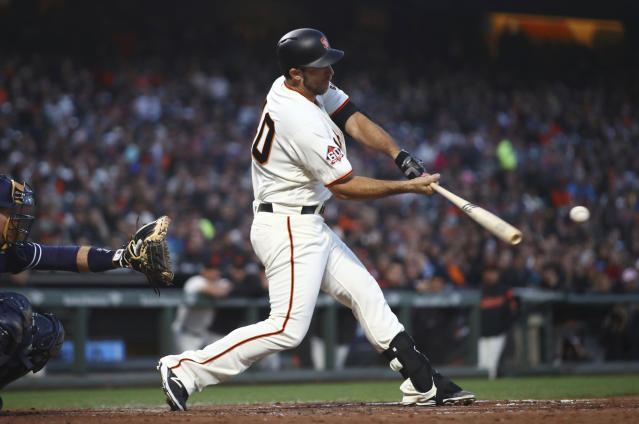 San Francisco Giants' Madison Bumgarner swings for an RBI sacrifice fly off San Diego Padres pitcher Tyson Ross during the fifth inning of a baseball game Thursday, June 21, 2018, in San Francisco. (AP Photo/Ben Margot)