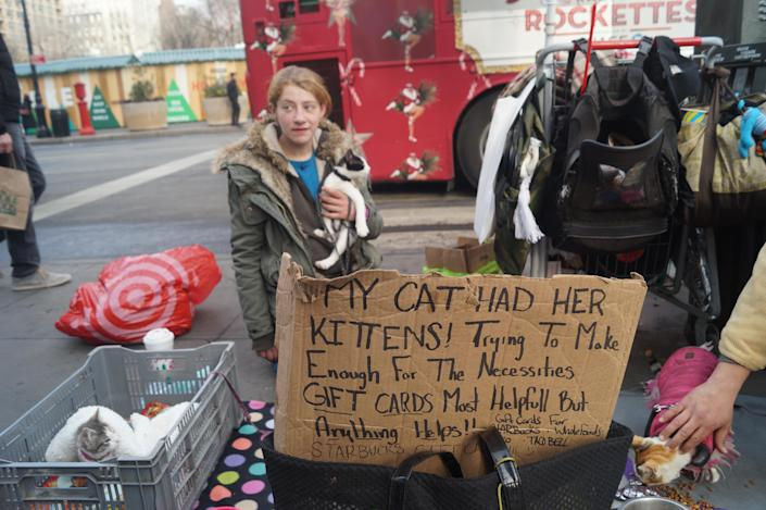 """<span class=""""s1"""">Brandy Felci, 23, who was raised in Staten Island, asks for money on 14th Street in Manhattan. She has been homeless on-and-off since leaving home as a teenager and said she cannot stay in shelters because they won't let her bring her cats. """"I refuse to give up my animals to be miserable inside by myself,"""" she said. """"I'd rather be on the street and fight for my animals' survival and my survival and know that I'm going to wake up happy every day with my animals in my arms than to be inside by myself and lonely."""" (Photo: Michael Walsh/Yahoo News)</span>"""