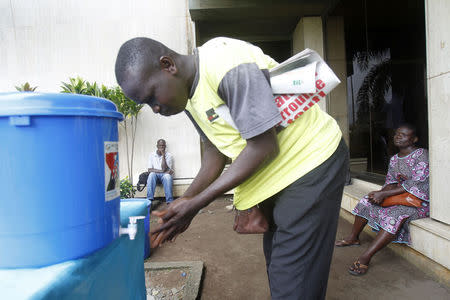 A man washes his hands as a preventive measure against Ebola in Abidjan August 11, 2014. REUTERS/Luc Gnago