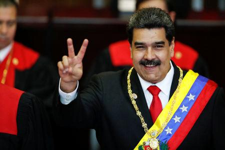 Venezuelan President Nicolas Maduro gestures after receiving the presidential sash during the ceremonial swearing-in for his second presidential term, at the Supreme Court in Caracas, Venezuela January 10, 2019. REUTERS/Carlos Garcia Rawlins