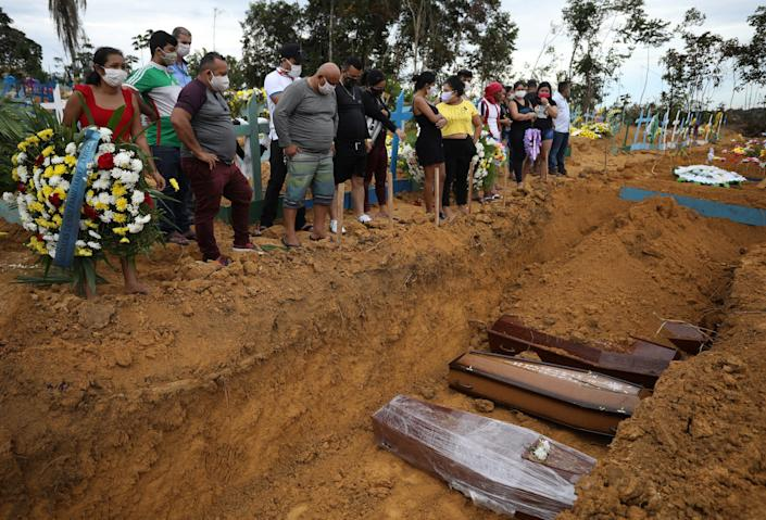 A collective burial of people that have passed away due to the coronavirus disease (COVID 19), is seen at the Parque Taruma cemetery in Manaus, Brazil April 23, 2020..JPG