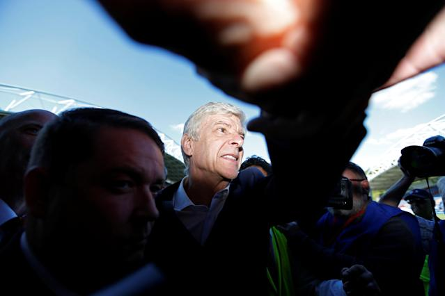 "Soccer Football - Premier League - Huddersfield Town vs Arsenal - John Smith's Stadium, Huddersfield, Britain - May 13, 2018 Arsenal manager Arsene Wenger shakes hands with the fans at the end of the match Action Images via Reuters/Andrew Boyers EDITORIAL USE ONLY. No use with unauthorized audio, video, data, fixture lists, club/league logos or ""live"" services. Online in-match use limited to 75 images, no video emulation. No use in betting, games or single club/league/player publications. Please contact your account representative for further details."