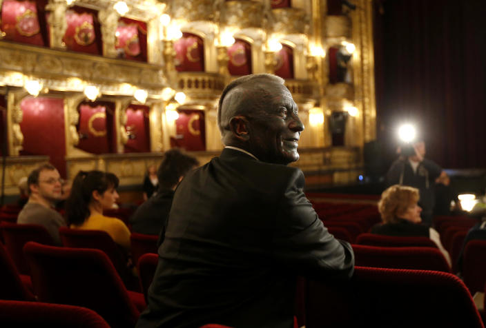 """Classical music composer and presidential candidate Vladimir Franz smiles prior to a rehearsal of his opera """"War with the Newts"""" at the State Opera in Prague, Czech Republic, Tuesday, Jan. 8, 2013. Franz is one of nine candidates running for President in the first round of the Czech Republic Presidential election on Jan. 11-12, 2013. (AP Photo/Petr David Josek)"""