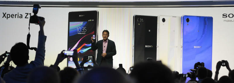 Kazuo Hirai, President and CEO of Sony presents the new Sony Xperia Z1 smartphone at an event ahead of the IFA, one of the world's largest trade fairs for consumer electronics and electrical home appliances in Berlin, Wednesday, Sept. 4, 2013. IFA will take place on the Berlin Exhibition Grounds from Sept 6 to Sept. 11, 2013 . (AP Photo/Markus Schreiber)