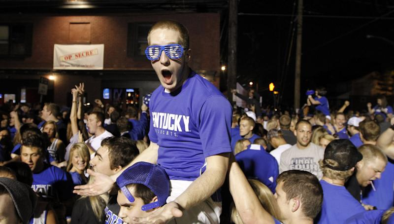 Ethen Farley yells with other Kentucky fans as they celebrate Kentucky's 69-61 win over Louisville in an NCAA Final Four semifinal college basketball tournament game, Saturday, March 31, 2012, in Lexington, Ky. (AP Photo/The Courier-Journal, James Crisp) NO SALES; MAGS OUT; NO ARCHIVE; MANDATORY CREDIT