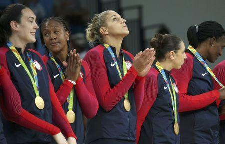 File photo: 2016 Rio Olympics - Elena Delle Donne (USA) of USA looks up after receiving her gold medal along with her teammates during the presentation ceremony for the women's basketball top finishers. REUTERS/Shannon Stapleton
