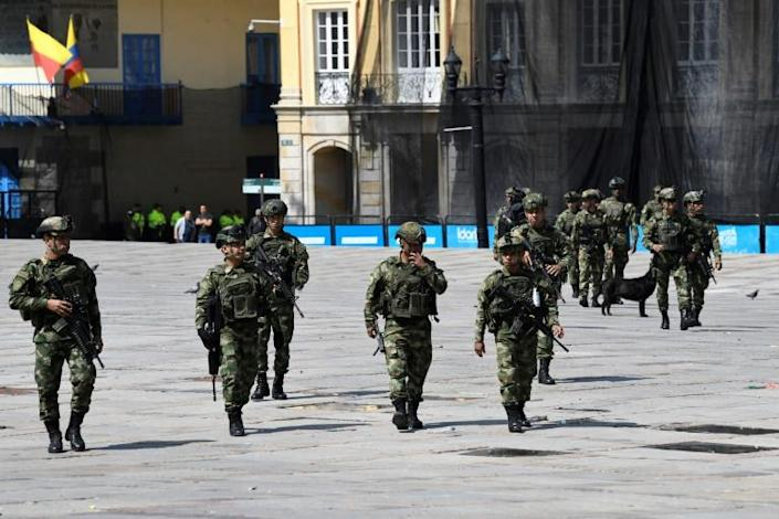 Soldiers patrol the streets of Bogota, Colombia on November 23, 2019 (AFP Photo/JUAN BARRETO)