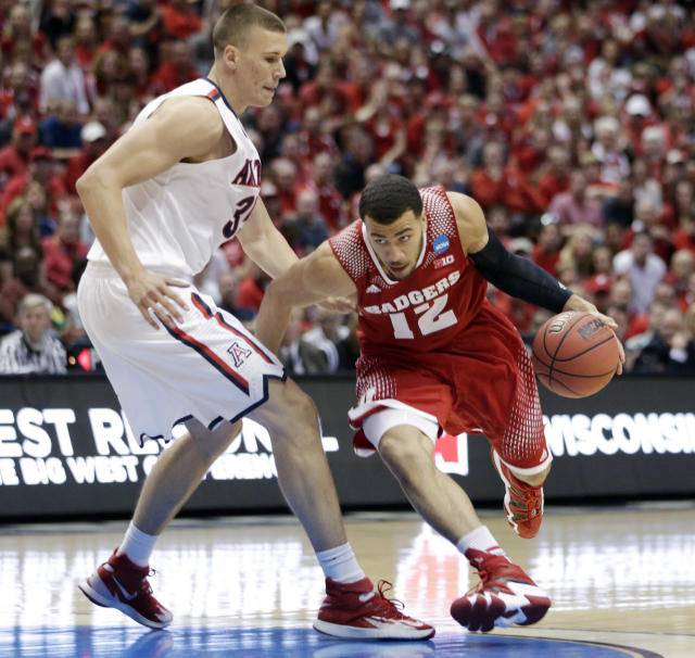 Wisconsin 's Traevon Jackson tries to drive past Arizona center Kaleb Tarczewski, left, during the first half in a regional final NCAA college basketball tournament game, Saturday, March 29, 2014, in Anaheim, Calif. (AP Photo/Jae C. Hong)