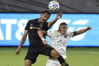 Los Angeles FC defender Eddie Segura, left, and Portland Timbers midfielder Marvin Loría battle for the header during the second half of an MLS soccer match in Los Angeles, Sunday, Nov. 8, 2020. (AP Photo/Kelvin Kuo)