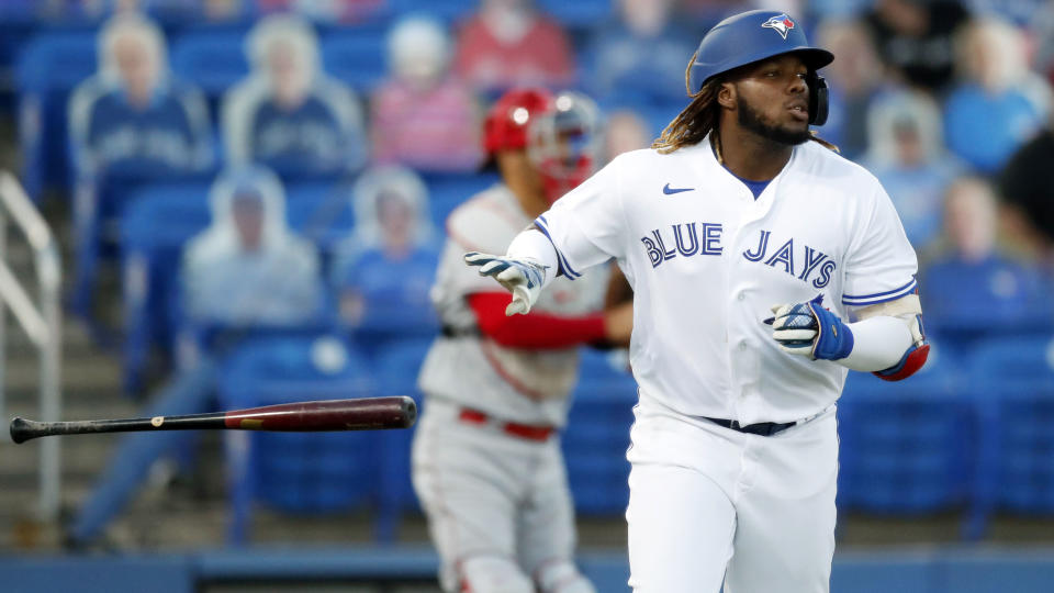 DUNEDIN, FL - APRIL 08: Vladimir Guerrero Jr. #27 of the Toronto Blue Jays hits a two run home run in the first inning during the game between the Los Angeles Angels and the Toronto Blue Jays at TD Ballpark on Thursday, April 8, 2021 in Dunedin, Florida. (Photo by Matt May/MLB Photos via Getty Images)