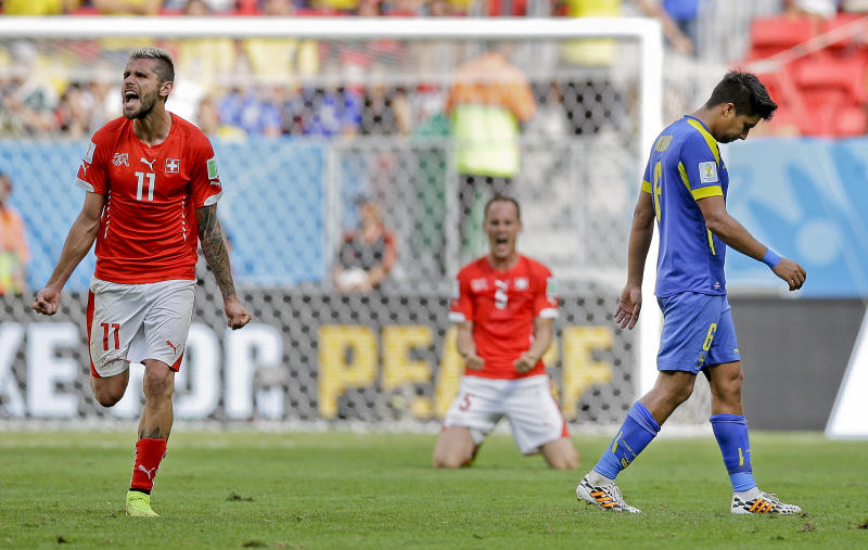 Behrami given credit for late Swiss winner