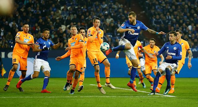 Soccer Football - Bundesliga - Schalke 04 vs TSG 1899 Hoffenheim - Veltins-Arena, Gelsenkirchen, Germany - February 17, 2018 Schalke's Guido Burgstaller shoots at goal REUTERS/Leon Kuegeler DFL RULES TO LIMIT THE ONLINE USAGE DURING MATCH TIME TO 15 PICTURES PER GAME. IMAGE SEQUENCES TO SIMULATE VIDEO IS NOT ALLOWED AT ANY TIME. FOR FURTHER QUERIES PLEASE CONTACT DFL DIRECTLY AT + 49 69 650050