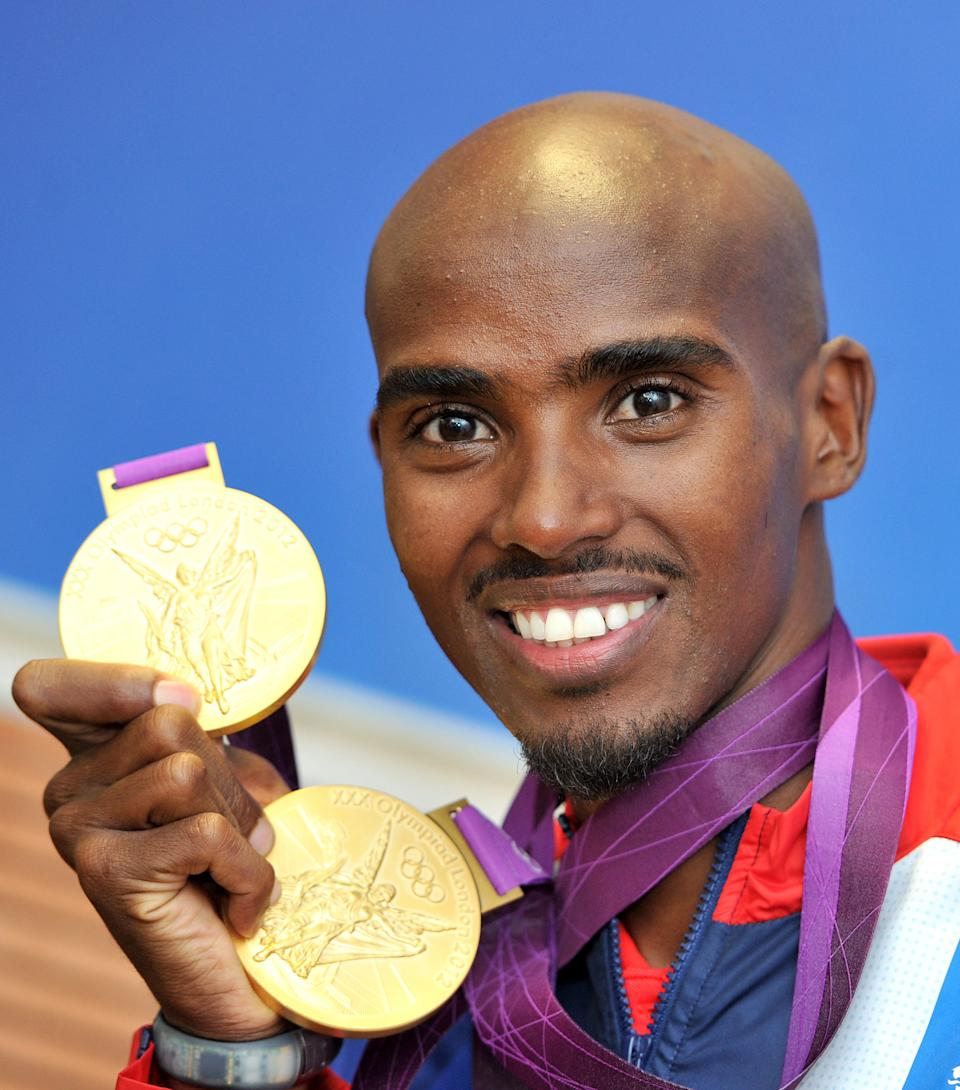 Great Britain's Mo Farah with his 2 Olympic gold medals he won in the Men's 10,000, and 5000m, pictured during a photcall at BOA House, Stratford, London   (Photo by Martin Rickett/PA Images via Getty Images)