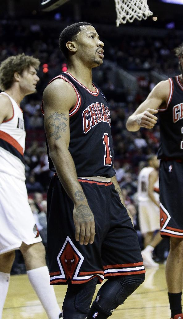 Chicago Bulls guard Derrick Rose walks to the bench during the first half of an NBA basketball game in Portland, Ore., Friday, Nov. 22, 2013. Rose injured his right knee late in the third quarter and left the game. The Trail Blazers won 98-95.(AP Photo/Don Ryan)