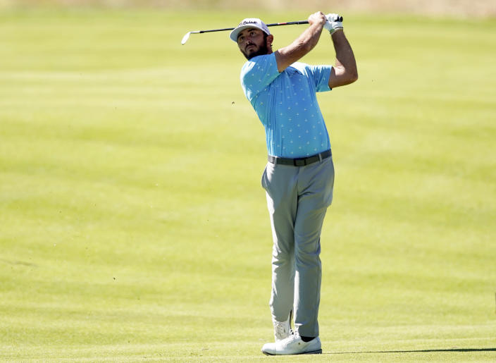 Max Homa watches his second shot on the seventh hole during the final round of the Genesis Invitational golf tournament at Riviera Country Club, Sunday, Feb. 21, 2021, in the Pacific Palisades area of Los Angeles. (AP Photo/Ryan Kang)