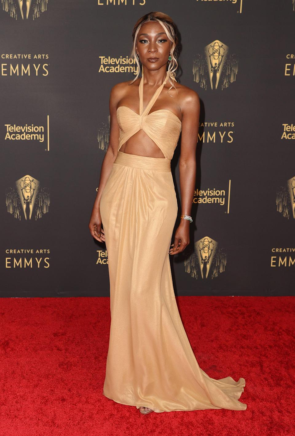 Angelica Ross looked chic in a cutout gown with a halter neck.