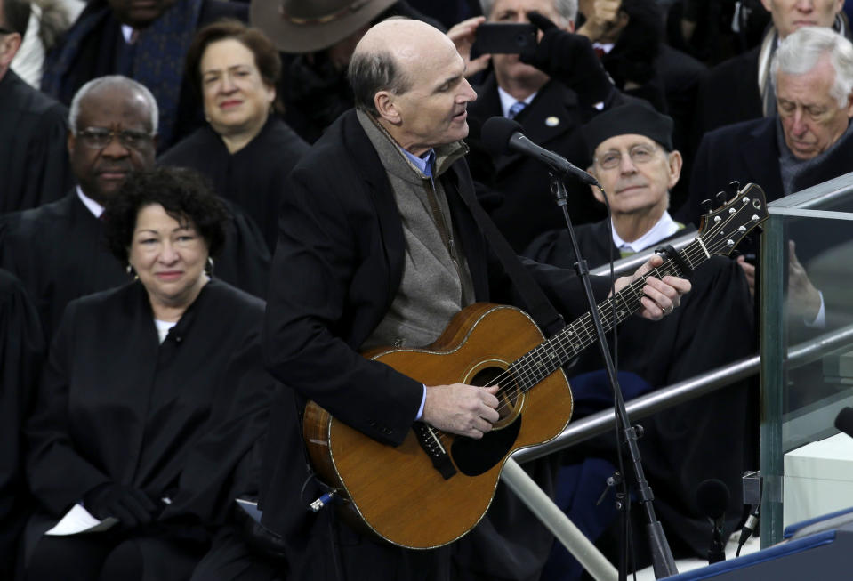 FILE - Singer James Taylor performs at the ceremonial swearing-in at the U.S. Capitol during the 57th Presidential Inauguration in Washington on Jan. 21, 2013. A-list celebrities are flocking back to inaugural events four years after many stayed away from the inauguration of Donald Trump, hugely unpopular in Hollywood. (AP Photo/Paul Sancya, File)