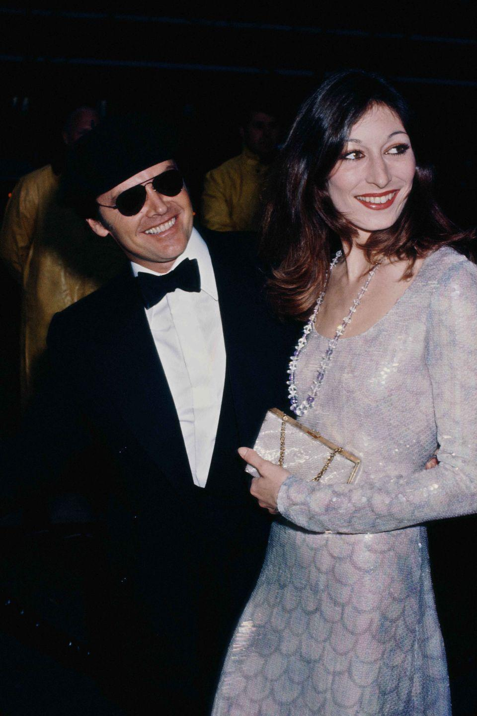 <p>Anjelica Huston in a long-sleeve sequined gown.</p>