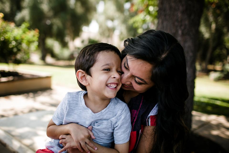 Mother & Autistic Son Laughing & Hugging