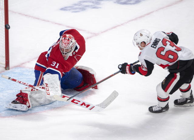 Montreal Canadiens goaltender Carey Price (31) makes the save on Ottawa Senators centre Tyler Ennis (63) during second period NHL hockey action in Montreal, Wednesday, Nov. 20, 2019. (Ryan Remiorz/The Canadian Press via AP)