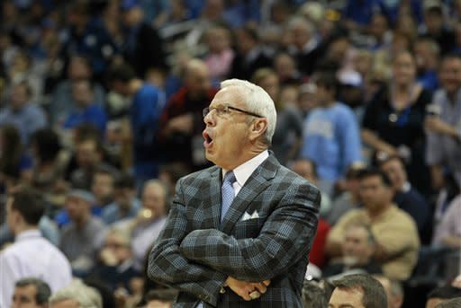 North Carolina head coach Roy Williams calls a play against North Carolina State during the second half of an NCAA college basketball game in the semifinals of the Atlantic Coast Conference tournament, Saturday, March 10, 2012, in Atlanta. (AP Photo/John Bazemore)